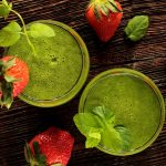 Two green smoothies and strawberries